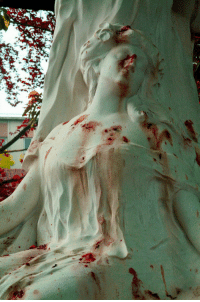 Tumblr, Blog, and Flower: sixpenceee:  Flower petals cause the appearance of blood stains on the grave of opera singer Jane Margyl in Batignolles cemetery in Paris.