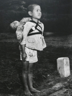 Saw, Taken, and Tumblr: sixpenceee:  THE BROTHERS AT NAGASAKI Probably one of the most intense picture I have ever posted. Extremely depressing content. The photograph above was taken by US Marines photographer Joe O'Donnell shortly after the bombing of Nagasaki. He saw things beyond imagining, and the experience left him with depression in his later years. Yet according to O'Donnell's son, the image above affected him more than any other. The younger child in the picture is dead. The older boy is his brother, and he'd carried his sibling on his back to a crematory. The older boy stayed and watched his brother burn yet refused to cry. He bit his lip so hard it bled. The boy had just lost everything to the most destructive force known to mankind. Yet, barefoot, he'd carried his sibling's body to ensure he was honored properly. It's a story of the extremes of sadness and bravery—and the photograph captures both.
