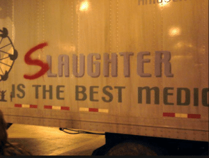 Graffiti, Best, and The Dark Knight: SLATUGHTER  IS THE BEST MEDIC The Dark Knight (2008) - The Joker's assault semi-truck has an graffiti S in front of the word laughter.