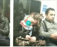 London, Total, and Woman: Sleepy London woman snuggles up to total stranger