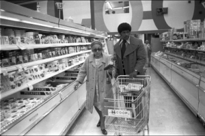 Head, Shoes, and Shopping: soldiers-of-war:  USA. California. Oakland. 1973. Leonard Colar helping a woman with her shopping as part of the Black Panther Senior Escort program.The program was just one of many programs the Panthers ran to address the needs of the poor and disadvantaged. In fact, they developed more than 60 Serve the People programs, including efforts to provide free clothing and shoes, medical services —including drug and alcohol awareness, —legal aid education, and what was thought to be some of the first true early childhood education programs in the nation, preceding Head Start. Photograph: Stephen Shames/Courtesy of Steven Kasher Gallery
