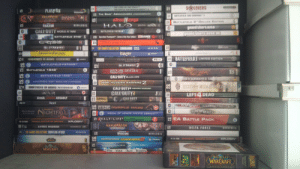 """Found a blurry photo of my game collection in 2012: SOLDIERS  OLEEARTM S  PLATO ON  TaLE BATTLE FOR  8THE Bs ABRACADABRA  BAFTLEFIELD BAG COMPANY#  On G  BATTLEFIELD OeLUXE EDnTION  2  HALO  gutc ENGE  28  taALAI  NOVALOGIC  gnand thers aut0  grand Gherocuc  CALLDUTY WORLD AT WAR  28  BATTLEFIELD VIETHAM""""  PCGAMER  BATTLEPIELD 2142  281  Operation FlashpointGame of the Vear Edition  CRYSIS  The Ofange Box  28  CO  CA  THE GAMES COLLECTION: COMMANDOS  FARCRY  EIDOS  PC  COURTER STrRIKE  28  GU WA  28  2a BATTLEFIEL03 LIMITED EDITION  OTHERS IN ARMS  PEARL HARDOK  PC-Co  Laasc  BATTLEFIELD VIETNAM  ainzeIE2  BATTLEFIELD 1942  RED ORCHESTRA  28  BATTLEFIELD 1942  CALL DUTY BLACK OPS  ODEN&DANGEROUS 2: 8A  ir  DATTLEFIELD 942 WORLD WAR ANTHOLcO  CALL-OUTY. MODERN WARFARE2  CS  HIDDES & DAMGEROUS  TNERS IN ARMS:  RR  CALLEDUTY4  MODERN WARFARE  CALL DUTY2  2a  WAR  LEFT 4 DEAD  ROMT  PANYACOORS  COMPANYHERDES  ASSAULT  ArmA:  CALL OUTY  28ACTIVSION  AON  PC  nesoPT  VIETCONG  DLO HAND  NIGHTFALL  OIGAM  WIKNO F  MEDAL OF HONDR PACIFIC ASSAULT  28 HALF-LIFE  2EA BATTLE PACK  BATTE ON TA  XPLOSIV  LDWARS  13 Do  Z:STEEL SOLDIERS  NOVALOGIC  DELTA FORCE  2THE GAMES COLLECTION: FRONTLINE ATTACK  CIDOS  UPERATONS  NOVALOGIC  PC CO  XPLOSIV  ON CvNASTY  SHANGHA  MOTOCROSS MADNESS  WART  SLOSE COMBATS  WORD  WARCRAFT  KMi TOUR Dwn iracks  WORLD  WARCRAFT  BIZ  99  99 93  21  PC  999 Found a blurry photo of my game collection in 2012"""