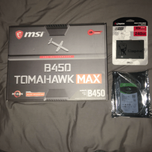 """First lot of parts just came in today. I should be getting the rest at the January sale.: SOLID-STATE DRIVE  DISQUE FLASH  DRIVE A STATO SOLIDO  кiнg on  10x  10x FASTER  A 400  FORISIENRL  GREING  240GB  LNS1315  3  5128538615  SINRS  Kingston  RD  MOTH  AMD  FREECHNICAL  SUPPORT  TNCE TEO E  2tang  B450  TOMAHAWK MAX  SEAGATE  IB450  AMDA  SARBACUO  AMDO  SOCKET  AM4  RYZEN  AMD RYZEN 3000 DESKTOP READY  Over Clocking Support  PCI Express 3.0