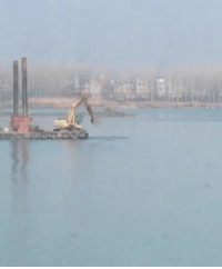 Dank, Race, and Boat: Some day we'll witness an excavator boat race.