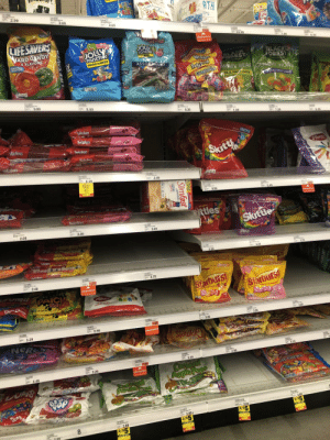 Someone abandoned their slimfast in the candy aisle.: Someone abandoned their slimfast in the candy aisle.