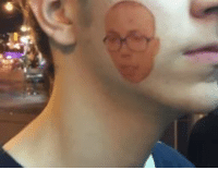 Someone spotted a temporary Anthony Fantano face tat at last night's Death Grips show...
