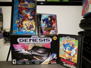 """I forgot to post this before leaving for the Holidays. This is the first time in 20 years that I've asked for a """"new Sega"""" for Christmas (R.I.P. Dreamcast.) Happy New Years, everyone!!: SONIC.CD  TM  Gan  Aintends Switch  Lite  TM  SONIC  ADVENTURE  EVERYONE  Rated by V.R.C  GA  SEGA  SONIC  0TEAM ESRB  SEGA  CONTENT RATED BT  $1117  SEAL OF  QUALITY  Appropriate for  all audiences.  SEGA  General Audiences  SEGA  GENESIS  bulbs  SEGA  any mirror  tools  OFFICIAL  SEGA  16 - T  TM  SEAL OF  QUALITY  GENESIS  CART AIOG E  NOT FOR RESALE  16-BIT VIDEO ENTERTAINMENT SYSTEM  SEGA Genesis Mini  JOIN THE  16-BIT  REVOLUTION  Wiju  JRAPHICS  GEN ESIS  16-BIT  KON  START  SEGA  GENESIS  TRIGGER  GENESIS  30  SONIC  HEDGEHO  CFFICIAL  GENESIS  ANNIVERGARY  SEAL OF  QUALITY  TEEN  Includes 