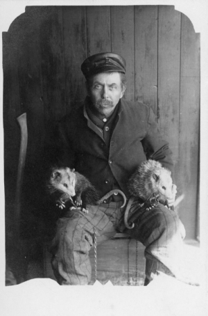 southernoir:Man has got him some possums.: southernoir:Man has got him some possums.