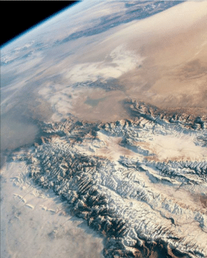 space-pics:  An astronaut in the international space station took this highly oblique photograph of the eastern Tien shan and Taklimakan desert in Central Asia: space-pics:  An astronaut in the international space station took this highly oblique photograph of the eastern Tien shan and Taklimakan desert in Central Asia