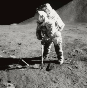 Tumblr, Apollo, and Blog: space-pics:  Astronaut James B. Irwin, lunar module pilot, uses a scoop in making a trench in the lunar soil during Apollo 15 extravehicular activity (EVA). Mount Hadley rises approximately 14,765 feet (about 4,500 meters) above the plain in the background. [1523 x 1536]