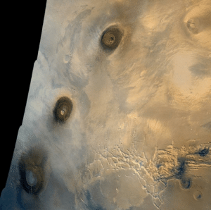 space-pics:  In 1980, Viking 1 orbiter captured this view of the Thesis region of Mars, where extinct volcanoes tower over the plains, evidence that the Red Planet was once volcanically active.: space-pics:  In 1980, Viking 1 orbiter captured this view of the Thesis region of Mars, where extinct volcanoes tower over the plains, evidence that the Red Planet was once volcanically active.