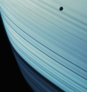 space-pics:  The rings are nearly edge-on in this equatorial view of Saturn and two of its moons – Mimas and Tethys. Cassini captured this image on July 16, 2005.: space-pics:  The rings are nearly edge-on in this equatorial view of Saturn and two of its moons – Mimas and Tethys. Cassini captured this image on July 16, 2005.