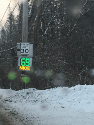 : SPEED  LIMIT  30  YOUR SPE  69  NICE