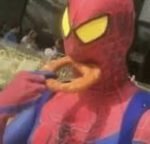 Spider-Man eating a big ass onion ring: Spider-Man eating a big ass onion ring