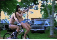 Apparently, Babes, and Bikini: Spotted this on Imgur - apparently this is how bikini babes ride bikes with shotguns - in Texas