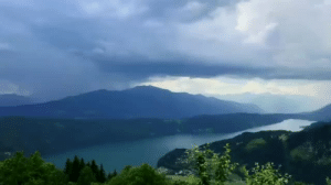 """Shower, Taken, and Target: srkile:  seldo:   sixpenceee:  Time-lapse of a rain storm. This is located in a lake in Carinthia, Austria called """"Millstättersee"""". Video taken byPeter Maier. More interesting posts here:sixpenceee.com/tagged/world  I never noticed before the way a rainstorm depletes the cloud it comes from.   Did someone turn on the shower?"""