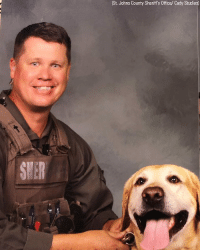 PICTURE PAW-FECT: Deputy Kowieski and K9 Patriot smiled for the camera last week at Ponte Vedra High School in Florida for picture day. The dynamic duo are assigned to the St. John's County Sheriff's Office's School Resource Unit and have been in the school district for years.: (St. Johns County Sheriff's Office/ Cady Studios) PICTURE PAW-FECT: Deputy Kowieski and K9 Patriot smiled for the camera last week at Ponte Vedra High School in Florida for picture day. The dynamic duo are assigned to the St. John's County Sheriff's Office's School Resource Unit and have been in the school district for years.