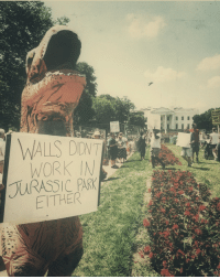 Protest, Berlin, and Berlin Wall: STAND  SAY  t RACI  WALLS DONT  URASSIC PRK  EITHER Protest of the Berlin Wall in Leipzig (October 1989)