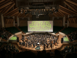 If you ever have the chance to watch STAR WARS in concert, I highly encourage you to go. This was as the Hong Kong symphony orchestra finished Return of the Jedi.: STAR  WARS  భ  ST  WA  WARS  STAR  WARS  887 If you ever have the chance to watch STAR WARS in concert, I highly encourage you to go. This was as the Hong Kong symphony orchestra finished Return of the Jedi.