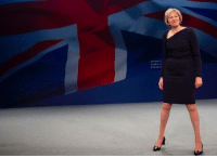 The UK's new prime minister Theresa May looks ready to smash a free kick into the top corner from 40 yards out.: sTASILIT The UK's new prime minister Theresa May looks ready to smash a free kick into the top corner from 40 yards out.