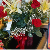 The grocery store had this awesome lily & rose arrangement. Happy Mother's Day to all the moms, grandmoms, and aunts out there!: Sue The grocery store had this awesome lily & rose arrangement. Happy Mother's Day to all the moms, grandmoms, and aunts out there!