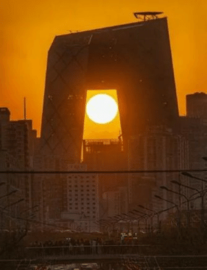 Sunset in between the CCTV headquarters on a busy day in Beijing, China: Sunset in between the CCTV headquarters on a busy day in Beijing, China