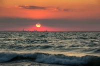 Sunset over Lake Michigan August 7. the silhouette of Chicago under the sun
