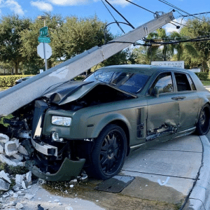 Totaled Rolls-Royce Phantom in Pompano Beach, Florida. The car was being test driven by a mechanic when a Ford Fusion took a left turn and blindsided the Phantom, running it into a pole.: SW &S  PARK  ONV.a K-O.G Totaled Rolls-Royce Phantom in Pompano Beach, Florida. The car was being test driven by a mechanic when a Ford Fusion took a left turn and blindsided the Phantom, running it into a pole.