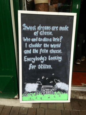 Head, Singing, and World: Sweetdrea are made  of Cheese,  Who unl todissa brie!  l cheddar Che World  and the Fete cheese.  Everybody's looking  for stilton.  O.0  Al I cant read this chalkboard without singing it in my head