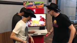 Fire, Funny, and Nintendo: SWITCH  NOA FUNNY borbtort: kreetn:  temporarilygoaty: [video: Hideo Kojima plays a nintendo switch game where he and another player (both of whom are wearing sheriff's hats) have a standoff, controllers at their sides, waiting to draw quicker than the other. Kojima adjusts his hat, looks at the onlookers, looks at the screen, then faces back to his opponent. they stare each other down for a tense moment. before the opponent can even react, Kojima draws first, lightning quick, and shoots. his opponent is visibly upset, having clearly underestimated Kojima, who begins flipping his controller around as if it were a revolver, finishing up by blowing the (non-existent) smoke from the barrel. an ocelot's meow echoes as the camera zooms in on his face]  You're…pretty good  i still can't believe he guesses the EXACT time it says fire. no human can react like that. then again..