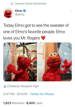 Elmo, Iphone, and Sesame Street: t Sesame Street Retweeted  Elmo  @elmo  Today Elmo got to see the sweater of  one of Elmo's favorite people. Elmo  loves you Mr. Rogers  WITH  OLS  AS  HER  & Childrens Museum Pgh  3:07 PM 6/14/19 Twitter for iPhone  1,823 Retweets 9,405 Likes Elmo visiting Mr. Rogers
