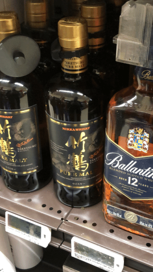 Japanese whiskey: TAKETSURU  PURE MALT  Bai  AKAWHISK  ESTE  WHISKY  NIKKAWHISKY  1ay whsfey is named in  wxMasataka Tahetsur,  Ballantin  we iy bn 1934.  TAKETS  WHISK  TAKETSURU  WHISKY  BLENDED SCOTCH WHI  PURE MAL  THE MIKKA WHISKY DISTILLING COLTDJA  RE MALT  wwwY DISTILLING CO.,LTD JAPAN  12  AGED  UCED BY  YEARS-  A Prectons and Casde Blemd frem  Scutwrds Fienat Drsthlerics  43%alc./vol.  ウイスキー  PRODUCT OF SCOTLANO  ウイスキー  GEORGE  SALLAMTINE  AND SOON  DUMBARTON  GS2 28S.  SCOTLAND  40ale /vl 40  T YETS R  AANTNES WHISKY 12A 40%  1000 1  EILLE 1L Japanese whiskey