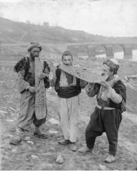 Tumblr, Blog, and Mesopotamia: tanyushenka:   Three men standing in a dirt field eating large pieces of flatbread Mesopotamia (undated)