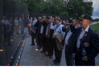 Visitors salute at the Vietnam Veterans Memorial during a candlelight vigil in honor of the late Sen. John McCain.: (Tasos Katopodis/Getty Images) Visitors salute at the Vietnam Veterans Memorial during a candlelight vigil in honor of the late Sen. John McCain.
