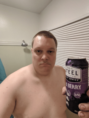 Beer, Shower, and Work: TE  EWING  STEEL  COMPANY  SRET  TEEL  3X71ו  68ןתטו  RESERVE  SycOT  OY SERIE S  BERRY  8.0%  ALC/VOL  245 The face, and drink, of a man who's boss called him an idiot at work and who's hot water heater is broken. Shower beer? More like shower tear.