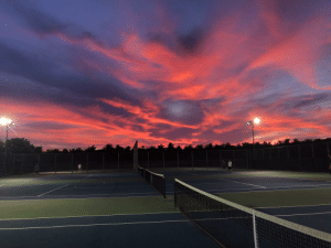Fire, Tennis, and Sky: Tennis Courts with the Sky on Fire