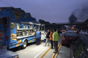 Taco truck start doing business during accident related traffic jam: tering  2530 Taco truck start doing business during accident related traffic jam