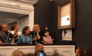 Banksys A girl with a red balloon shreds itself within the frame after being sold for £1 million pounds.: thcby's  Sothebys Banksys A girl with a red balloon shreds itself within the frame after being sold for £1 million pounds.