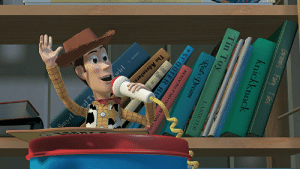 [Toy Story] Look at the books behind Woody. The Adventures of Andre and Wally B., Tin Toy, and Knick Knack are all the titles of short films that Pixar produced prior to Toy Story.: The Adventure  Smyrl yrl Ty  Grimen's Fainy Tales  knickknack  ieyr  Bure  Tin Toy  LASSETER  Red's Dream  NOLLVOVA V NO 0 A N NV  SCOOTER RU  wirl [Toy Story] Look at the books behind Woody. The Adventures of Andre and Wally B., Tin Toy, and Knick Knack are all the titles of short films that Pixar produced prior to Toy Story.