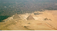 The ancient pyramids of Giza are located right up against the modern city of Cairo.: The ancient pyramids of Giza are located right up against the modern city of Cairo.