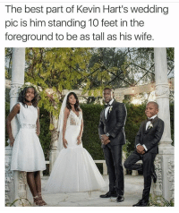 We aren't blind @kevinhart4real 😂: The best part of Kevin Hart's wedding  pic is him standing 10 feet in the  foreground to be as tall as his wife. We aren't blind @kevinhart4real 😂