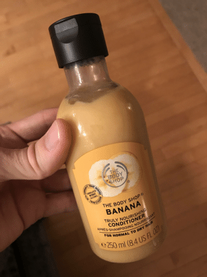 Forbidden banana shake: THE  BODY  SHOP  TRADE  FORMULATED  WITHOUT  SILICONES  THE BODY SHOP  BANANA  RULY NOURISHING  CONDITIONER  APRES-SHAMPOOING NOURRISSANT  FOR NORMAL TO DRY HAIR  e 250 ml (8.4 US FL OZ  BANANA  ALINOW Forbidden banana shake