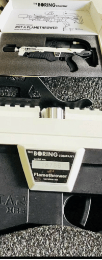 """Not a Flamethrower"": THE BORING cOMPANTY  BORING  THE BORING COMPANY  NOT A FLAMETHROWER  WHAT'S IN THE BO  BRING COMPANY  THE BORING COMPANY  serial no.  Flamethrower  version ""Not a Flamethrower"""