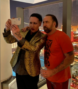 The crossover we've all been waiting for. Proof that Marilyn Manson and Nicholas Cage are Not the same person: The crossover we've all been waiting for. Proof that Marilyn Manson and Nicholas Cage are Not the same person