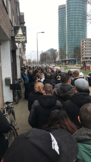 The Dutch waiting in line to buy weed as coffeeshops are closing down in an hour.: The Dutch waiting in line to buy weed as coffeeshops are closing down in an hour.