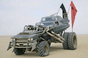 """The Gigahorse from Mad Max Fury Road was made from two 1959 Cadillac Coupe de Villes and has two V8 engines mounted together. Production Designer Collin Gibson described it as """"In a world where there's barely one of anything, to show you had power, he's the man who's got two of everything."""": The Gigahorse from Mad Max Fury Road was made from two 1959 Cadillac Coupe de Villes and has two V8 engines mounted together. Production Designer Collin Gibson described it as """"In a world where there's barely one of anything, to show you had power, he's the man who's got two of everything."""""""