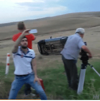 Memes, Selfie, and 🤖: The guy casually sitting there taking a selfie while a car flips behind him 😂 📹:Mevlud Meladze