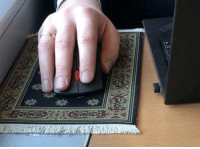 Mouse, Table, and Carpet: The guy sitting across the table brought a tiny carpet for his mouse