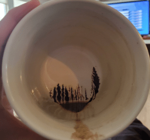 The inside of my coffee cup this morning looks like the woods in front of a lake: The inside of my coffee cup this morning looks like the woods in front of a lake