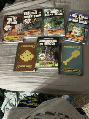 Flexing, Minecraft, and New York: THE JUNGLE  TEMPLE DRACLE  AN UNOFFICAL NOVEL  TROUBLE IN  ZOMBIE-TOWN  ANUNOACAL NOV  AN UNOFFICAL NOVEL  LAST STAND  ON THE  OCEAN SHORE  NUNORA NOVR  BATTLE  FOR THE  NETHER  155  aINSARE  AR  INAFCIAL  WINECRAFTEN'S  ADVENTURE  ans  MYSTERY nr NEROERINE  noOK TWO  RE MYSTERY NEROBRINE  B0OK ONE  AN  ACIAL  MINECRAFTERS  AA BAMEKRIGRTB## ADVENTURE  AIVENTURE  MARK CHEVERTON  NEW YORK TINES BESTSELLING AUTHOR  A EUNETS ADVENTURE S  TNE MYSTERY as  MARK CHEVERTON  HERDERINE  BOOK THREE  44AA EAMEKRERTSS ADVENTURE>  NEW YORK INES BESTSELLING AUTNOR  SOOK TWO IN E  GAMENNIGNT9SS SERIES  MARK CHEVERTON  NEW YORK TIMES BESTSELLING AUTHOR  AN UNOFFICIAL NOVEL  NARK CHEVERTON  EW YORK NIES BESTSELLING AUTNOR  CONFRONTING  THE DRAGON  MINECRAFT  MINECRAFT  NDJANG  MCFTERS  AAETURE  BOOK THREE IN THE  GAMEKNIGHT999 SERIES  MARK CHEVERTON  NEW YORK TIMES BESTSELLING AUTHOR  REDSTONE HANDEOON  conSTRUCTIONn HRNDBOON Big flex